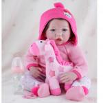 Девочка в розовом вязаном свитере (56 см)